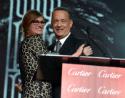 Julia Roberts presents Chairman's Award to Tom Hanks (photo: Charley Gallay / Getty Images)